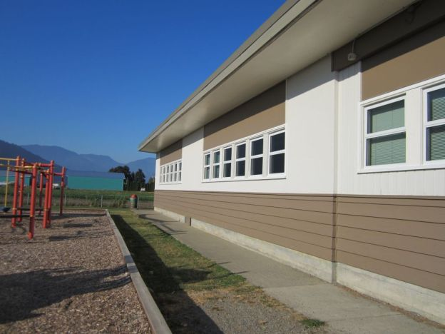 Exterior renovation to two elementary schools and facilities office by Olympic Projects